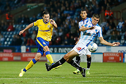 Don Cowie of Wigan shoots past Conor Coady of Huddersfield - Photo mandatory by-line: Rogan Thomson/JMP - 07966 386802 - 16/09/2014 - SPORT - FOOTBALL - Huddersfield, England - The John Smith's Stadium - Huddersfield Town v Wigan Athletic - Sky Bet Championship.