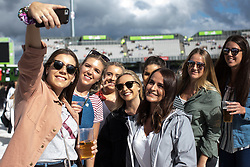 © Licensed to London News Pictures . 04/06/2017 . Manchester , UK . A group of young women pose for a selfie as the crowd gathers in front of the stage . The One Love Manchester benefit concert for victims of the Manchester Arena terrorist attack , at the Emirates Old Trafford Cricket Stadium . Ariana Grande, Justin Bieber, Coldplay, Katy Perry, Miley Cyrus, Pharrell Williams, Usher, Take That, Robbie Williams, Black Eyed Peas and Niall Horan are amongst the performers . Photo credit : Joel Goodman/LNP