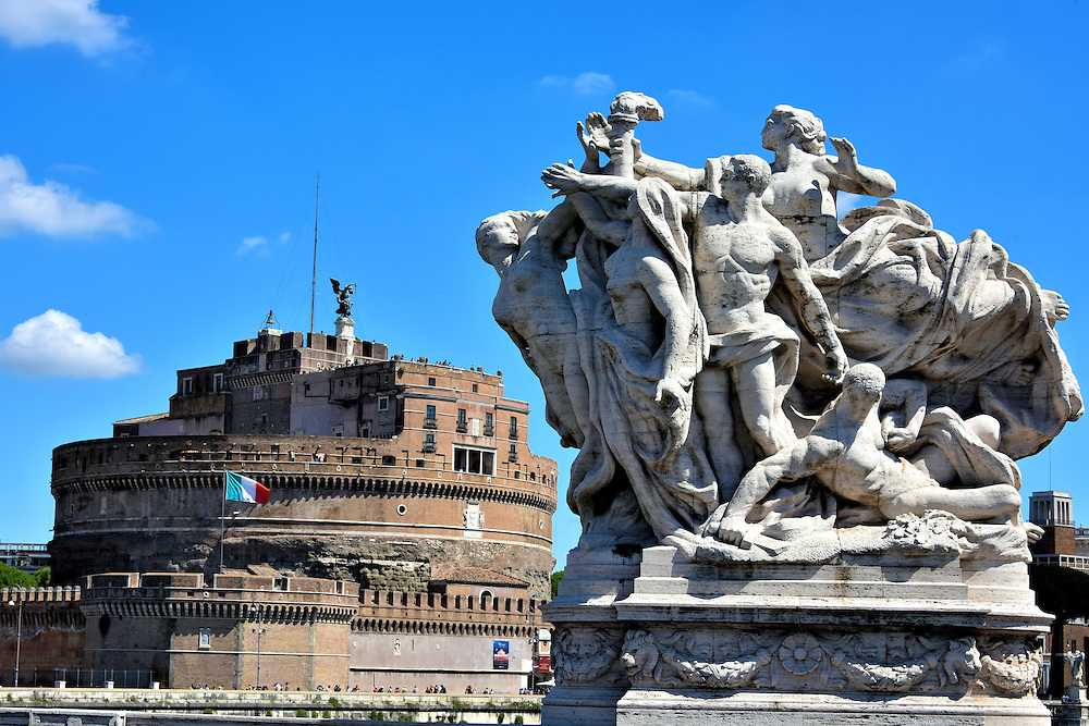 Allegorical Statue on Ponte Vittorio Emanuel II in Rome, Italy <br />