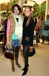 Left to right, POPPY FRASER and LADY ELOISE ANSON at a fashion show of Sybil Stanislaus Summer 2005 collection with jewellery by Philippa Holland held at The Lanesborough Hotel, Hyde Park Corner, London on 13th April 2005.<br /><br />NON EXCLUSIVE - WORLD RIGHTS