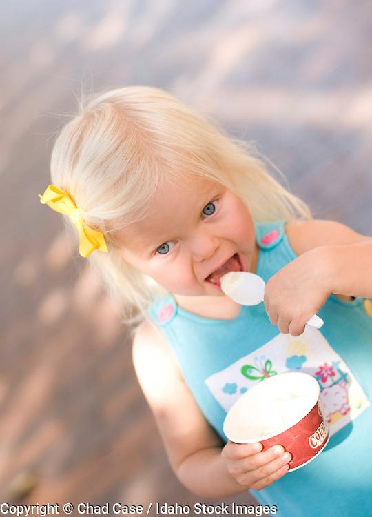 Idaho, Downtown Boise. Little girl eating ice cream. MR