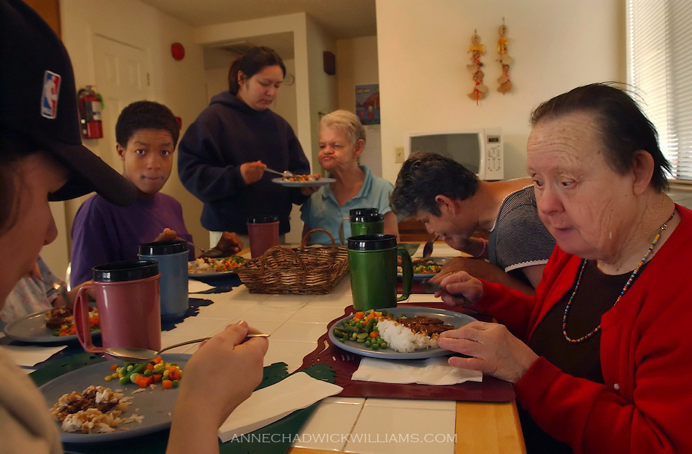 Irene Pinole is one of the oldest people with Down Syndrome. Irene, 76, right, sits down for dinner with the five other women she lives with in her Sacramento group home. Pinole is one of the oldest living people with Down Syndrome. Anne Chadwick Williams /May  2004 / Sacramento Bee