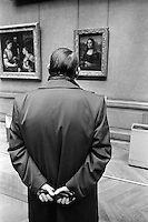 1982, Paris, France --- Man Looking at the Mona Lisa --- Image by © Owen Franken