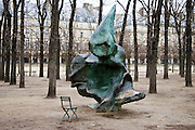 Modern sculpture work of art and vacant chair from which to view it in Jardin des Tuileries, Paris, France