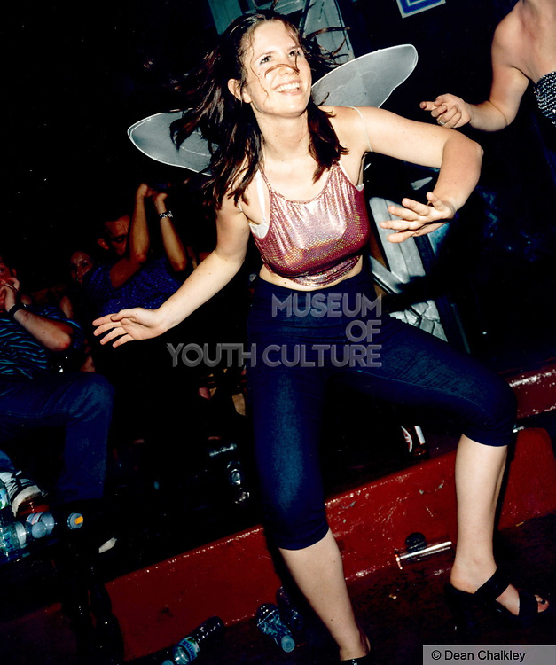 Dancing girl wearing angel wings, Ibiza 1998