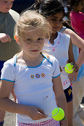 Children preparing to take part in sports day competition in school playground,