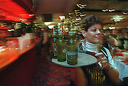 Globe photo Bethany Versoy   story/  SOWK    West Bridgewater Ma.; Canoe Club Ballroom. Waitress Juanita Lewis  carries a tray of non alcoholic beer to a table.RESTRICTED USE.NOT FOR REPBULICATION WITHOUT EXPLICIT APPROVAL FROM DIRECTOR OF PHOTOGRAPHY
