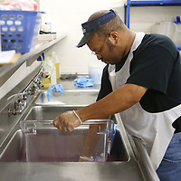 Lauren Wood   Buy at photos.djournal.com<br /> Michael Goins, Jr. washes a bin Friday morning in the cafeteria at Tupelo High School, which is an important step in the food service process.