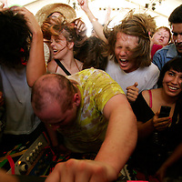 Crystal Chatham/The Desert Sun<br /> <br /> 04/25/2008 -- Fans surround electronica artist Dan Deacon as he performs in the Gobi Tent on Friday, April 25, 2008 during the opening day of Coachella Valley Music and Arts Festival at Empire Polo Field in Indio, Calif.