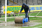 Ground staff out with the squeegee rollers to remove puddles from the pitch as heavy rain from Storm Dennis falls at the Memorial Stadium ahead the EFL Sky Bet League 1 match between Bristol Rovers and Blackpool at the Memorial Stadium, Bristol, England on 15 February 2020.