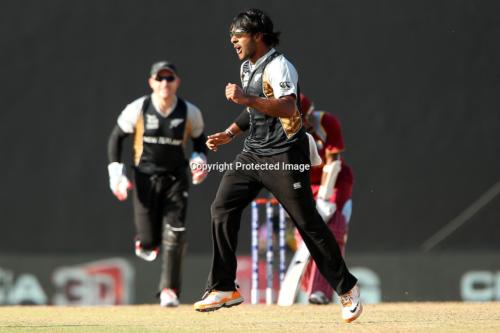 Roneel Hira celebrates the wicket of Denesh Ramdin of The West Indies during the ICC World Twenty20 Super Eights match between The West Indies and New Zealand held at the  Pallekele Stadium in Kandy, Sri Lanka on the 1st October 2012<br /> <br /> Photo by Ron Gaunt/SPORTZPICS/PHOTOSPORT