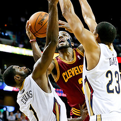 Nov 22, 2013; New Orleans, LA, USA; Cleveland Cavaliers point guard Kyrie Irving (2) is fouled by New Orleans Pelicans point guard Tyreke Evans (1) as power forward Anthony Davis (23) defends during the second half of a game at New Orleans Arena. The Pelicans defeated the Cavaliers 104-100. Mandatory Credit: Derick E. Hingle-USA TODAY Sports
