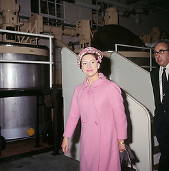 Smiling Princess Margaret in a rose pink woolen coat, worn over a pink dress, and a pink and grey hat of oriental style during her visit to Liverpool Medical Institution to open a £50,000 extension.