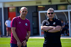NEWPORT, WALES - Saturday, May 19, 2018: Manchester City's head of football Simon Davies (left) and Osian Roberts (right) during day two of the Football Association of Wales' National Coaches Conference 2018 at Dragon Park. (Pic by David Rawcliffe/Propaganda)
