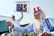 Daily Photo by Gary Cosby Jr. <br /> <br /> Paul Rook holds an anti-Obama sign while William House, dressed as Uncle Sam, points to someone during a Republican National Committee rally at the Space and Rocket Center in Huntsville.  The RNC is supporting congressional candidates such as 5th district candidate Mo Brooks who was the featured speaker in their effort to retake the House majority.