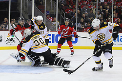 Jan 4, 2012; Newark, NJ, USA; Boston Bruins defenseman Johnny Boychuk (55) skates away with the rebound after a save by Boston Bruins goalie Tim Thomas (30) during the second period at the Prudential Center.