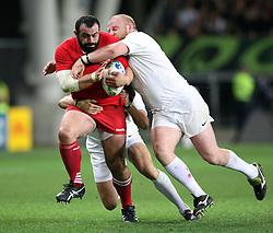 Georgia's David Zirakashvili, left, in the tackle of England's Dan Cole in the Rugby World Cup pool match at Otago Stadium, Dunedin, New Zealand, Sunday, September 18, 2011. Credit:SNPA / Dianne Manson.