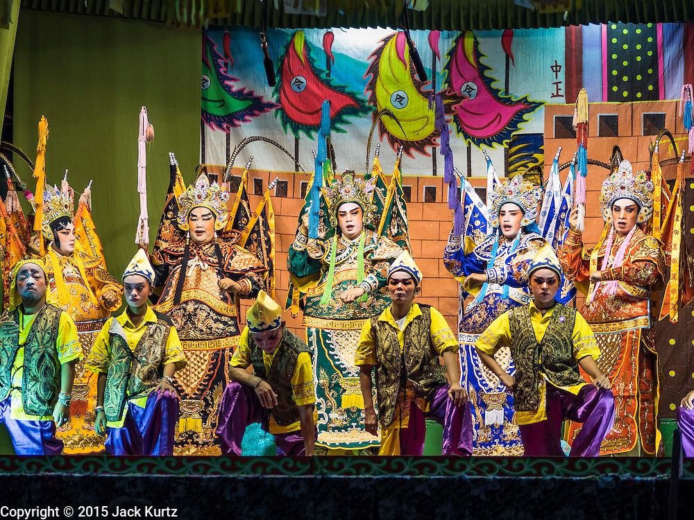 15 OCTOBER 2015 - BANGKOK, THAILAND:  A Chinese opera performance during the Vegetarian Festival at the Joe Sue Kung Shrine in the Talat Noi neighborhood of Bangkok. The Vegetarian Festival is celebrated throughout Thailand. It is the Thai version of the The Nine Emperor Gods Festival, a nine-day Taoist celebration beginning on the eve of 9th lunar month of the Chinese calendar. During a period of nine days, those who are participating in the festival dress all in white and abstain from eating meat, poultry, seafood, and dairy products. Vendors and proprietors of restaurants indicate that vegetarian food is for sale by putting a yellow flag out with Thai characters for meatless written on it in red. The shrine is famous for the Chinese opera it hosts during the Vegetarian Festival. The operas are free.   PHOTO BY JACK KURTZ