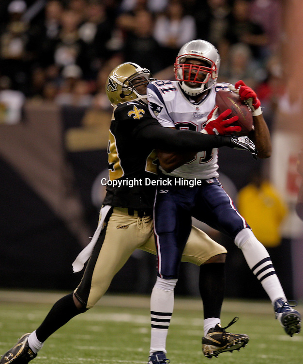2009 November 30:  New England Patriots wide receiver Randy Moss (81) catches a pass in front of New Orleans Saints defensive back Chris McAlister (29) during the first half at the Louisiana Superdome in New Orleans, Louisiana.