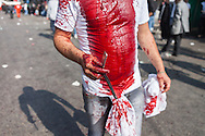 Mourning shiite muslim man, carrying a sharp razor, covered in his own blood, during the Day of Ashura, Nabatieh, Lebanon (November 14, 2013).