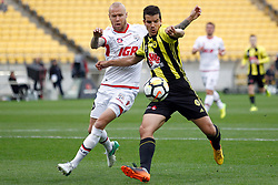 Adelaide United's Taylor Regan, left and the Phoenix's Andrija Kaluderovic battle for possession in the A-League football match at Westpac Stadium, Wellington, New Zealand, Sunday, October 08, 2017. Credit:SNPA / Dean Pemberton **NO ARCHIVING**