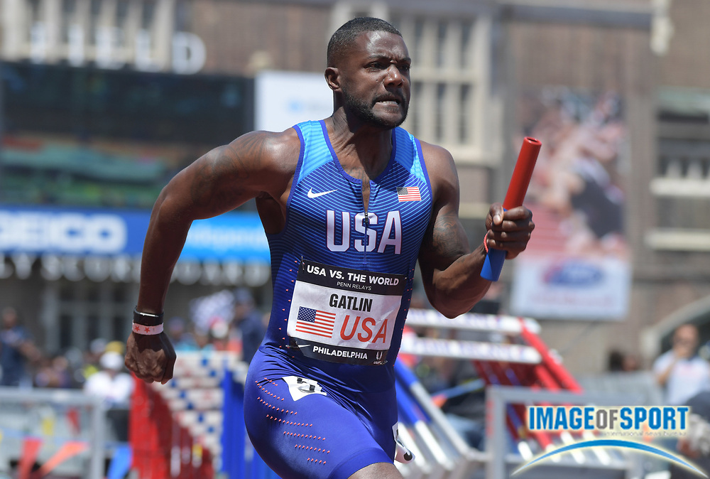 Apr 28, 2018; Philadelphia, PA, USA; Justin Gatlin runs the second leg on the USA Red 4 x 100m relay that won the USA vs. the World race in 38.39 during the 124th Penn Relays at Franklin Field.