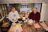 IVYLAND, PA - DECEMBER 15: Ivyland Boro Heritage Assoc. Vice President Ed Oldroyd and President Tony Judice look through the old issues of the Loud Speaker December 15, 2014 in Ivyland, Pennsylvania. The basement of the Ivyland School is filled with boxes of recently discovered issues of the Loud Speaker, a periodical, thought lost,that the borough published for years- Copies date back to the 20s and they provide a window on the borough's and county's past. (Photo by William Thomas Cain/Cain Images)