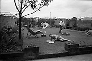 15/06/1963<br /> 06/15/1963<br /> 15 June 1963<br /> Mr. J. Doyle and family at home, 133 Foxfield Park, Raheny, gardening special for Irish Shell.