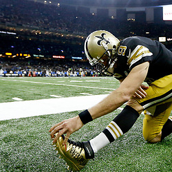 Dec 4, 2016; New Orleans, LA, USA; New Orleans Saints quarterback Drew Brees (9) wearing custom cleats supporting the Brees Dream Foundation stretches before a game against the Detroit Lions at the Mercedes-Benz Superdome. Mandatory Credit: Derick E. Hingle-USA TODAY Sports