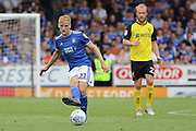Ipswich Town midfielder Flynn Downes passes the ball in midfield during the EFL Sky Bet League 1 match between Burton Albion and Ipswich Town at the Pirelli Stadium, Burton upon Trent, England on 3 August 2019.