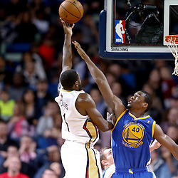 Nov 26, 2013; New Orleans, LA, USA; New Orleans Pelicans point guard Tyreke Evans (1) shoots over Golden State Warriors small forward Harrison Barnes (40) during the second half of a game at New Orleans Arena. The Warriors defeated the Pelicans 102-101. Mandatory Credit: Derick E. Hingle-USA TODAY Sports