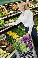 Senior woman shopping for vegetables in market