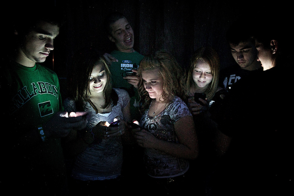 Felicia and her friends illuminated by the glow of their cell phones in our backyard during her 15th birthday party Friday, July 1, 2011.