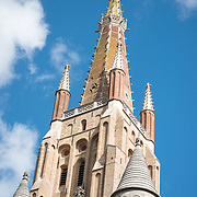 The steeple of the Church of Our Lady in Bruges, Belgium. The church dates mainly from the 13th-15th centuries. Its tower, at 122.3 meters in height, remains the tallest structure in the city and the second tallest brickwork tower in the world