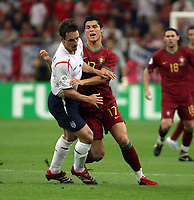 Photo: Chris Ratcliffe.<br /> England v Portugal. Quarter Finals, FIFA World Cup 2006. 01/07/2006.<br /> Cristiano Ronaldo of Portugal clashes with Gary Neville.