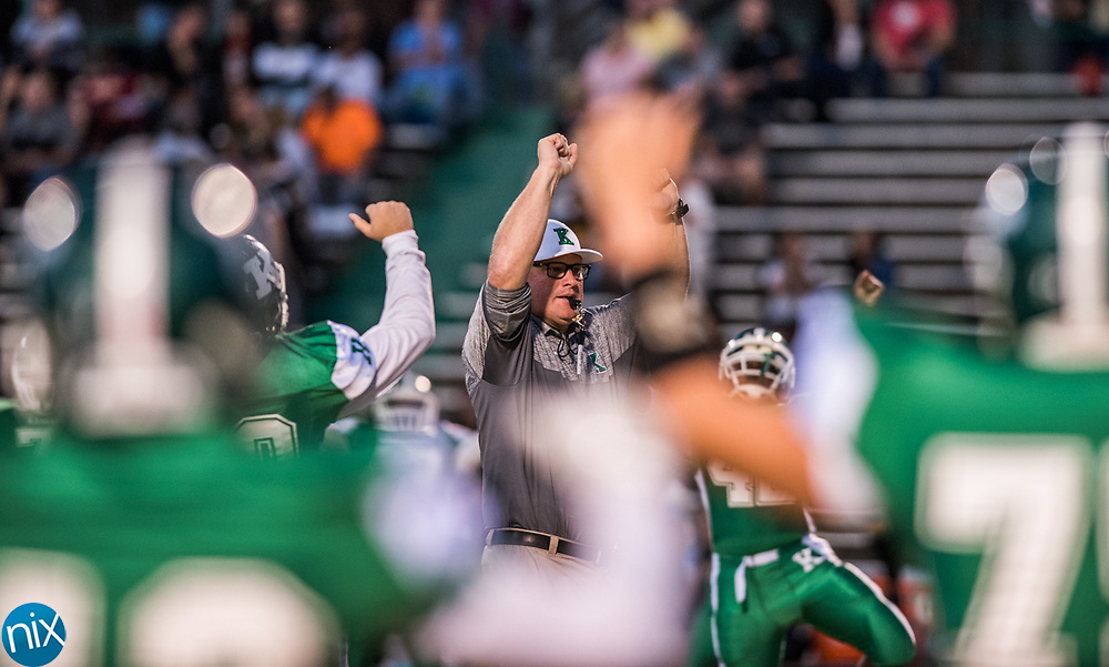 Kannapolis head coach Mike Newsome gets his team ready to take on Concord in the annual Battle for the Bell game. Kannapolis won 14-12.