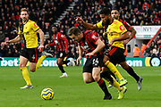 Ryan Fraser (24) of AFC Bournemouth on the attack being challenged by Adrian Mariappa (6) of Watford during the Premier League match between Bournemouth and Watford at the Vitality Stadium, Bournemouth, England on 12 January 2020.
