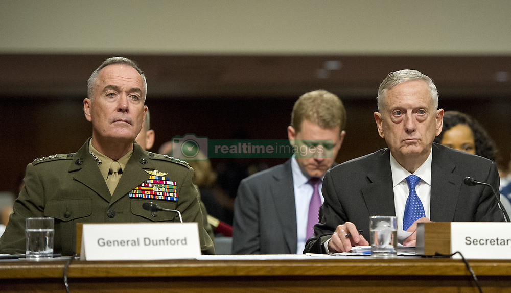 June 13, 2017 - Washington, District of Columbia, U.S. - United States Secretary of Defense JAMES N. MATTIS, right, and General JOSEPH F. DUNFORD, JR., US Marine Corps, Chairman of the Joint Chiefs of Staff, left, give testimony before the US Senate Committee on Armed Services on ''the Department of Defense budget posture in review of the Defense Authorization Request for Fiscal Year 2018 and the Future Years Defense Program'' on Capitol Hill. (Credit Image: © Ron Sachs/CNP via ZUMA Wire)
