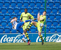 COLCHESTER, ENGLAND - Saturday, April 24, 2010: Tranmere Rovers' John Welsh gets his body in the way of Colchester United's David Prutton's volley during the Football League One match at the Western Community Stadium. (Photo by Gareth Davies/Propaganda)