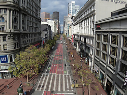 March 19, 2020, San Francisco, California, USA: With stores like Nordstrom, and GAP at left, closed, and people staying home for the Shelter in Place order due to coronavirus. Market St. seen from above, had far fewer pedestrians than usual, in San Francisco. (Credit Image: © Paul Kuroda/ZUMA Wire)