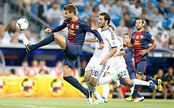 29.08.2012, Estadio Santiago Bernabeu, Madrid, ESP, Supercup, Real Madrid vs FC Barcelona, Rueckspiel, im Bild Real Madrid's Gonzalo Higuain against Barcelona's Gerard Pique // during the Spanish Supercup 2nd Leg Match match between Real Madrid CF and Barcelona FC at the Estadio Santiago Bernabeu, Madrid, Spain on 2012/08/29. EXPA Pictures © 2012, PhotoCredit: EXPA/ Alterphotos/ Alvaro Hernandez..***** ATTENTION - OUT OF ESP and SUI *****