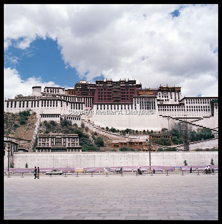 After the Chinese occupation in Tibet, the Potala has been surrounded by tourist stores.  Situated on the side of Marpo Ri, it was the primary residence of His Holiness the Dalai Lama until he fled Tibet in 1959 to Dharamsala, India.  The Palace was constucted under the fifth Dalai Lama beginning in 1645.