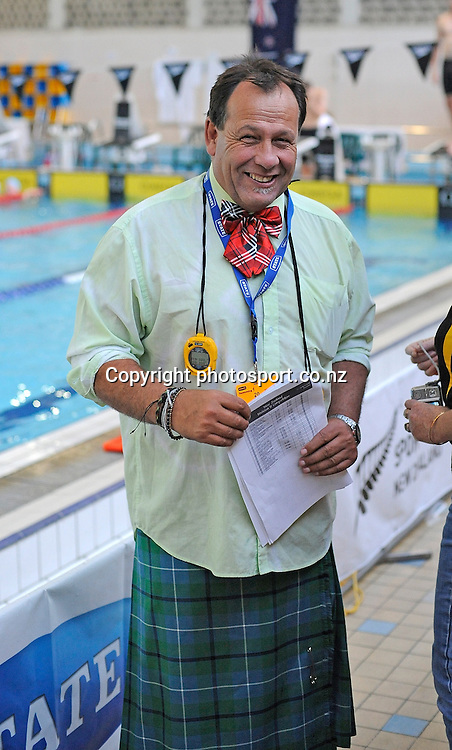 Coach laughs, at the State New Zealand Division II Swimming Champs, at Moana pool, Dunedin, New Zealand. Friday 14 April 2012. Photo: Richard Hood photosport.co.nz