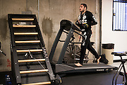 UFC lightweight Thibault Gouti of France trains on a treadmill after class at Jackson Wink MMA in Albuquerque, New Mexico on June 10, 2016.