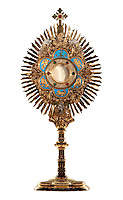 The Blessed Sacrament contained in a gold monstrance.  photo by lisa johnston