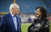 (L-R) Houston Texans Robert C. McNair Founder, Chairman, and CEO talks to Jacksonville Jaguars owner Shahid Khan before the NFL week 14 football game against the Houston Texans on Thursday, Dec. 5, 2013 in Jacksonville, Fla. The Jaguars won the game 27-20. ©Paul Anthony Spinelli