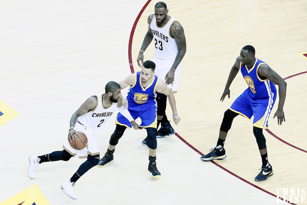 08 June 2016: Golden State Warriors guard Stephen Curry (30) and Golden State Warriors forward Draymond Green (23) defend on Cleveland Cavaliers guard Kyrie Irving (2) next to Cleveland Cavaliers forward LeBron James (23) during the Cleveland Cavaliers 120-90 victory over the Golden State Warriors, during Game Three of the 2016 NBA Finals at the Quicken Loans Arena, Cleveland, Ohio, USA.