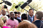 Josephus Weeks, nephew of Ebola patient Thomas Eric Duncan, and his son Josephus Weeks, Jr. and Rev. Jesse Jackson speak during a prayer vigil for Duncan at Texas Health Presbyterian Hospital on October 7, 2014, in Dallas. (Cooper Neill for The New York Times)