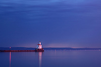 WI00179-00...WISCONSIN - Sunrise at Wisconsin Point Lighthouse on Lake Superior near the town of Superior.