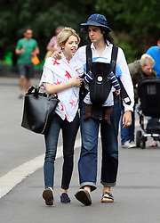Peaches Geldof, fiancé Thomas Cohen and baby boy Astala take their beloved dog Parpy to the park. Peaches wearing a wrap around star scarf, jeans and blue suede shoes was all smiles as she walked around the park, before their dog Parpy had an encouter with a vicious little dog... UK. 28/07/2012<br />